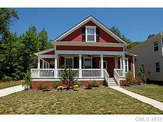 craftsman style house plans with wrap around porch red craftsman style home with wrap around porch charming