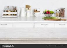 Kitchen Background Images by Wooden Table On Blurred Kitchen Interior Background With