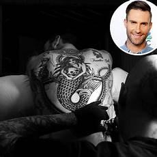 adam levine got a massive mermaid tattooed on his back