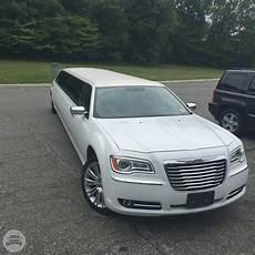 Hourly Chrysler white 2014 chrysler 300 limousine motor city limousine
