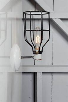 industrial wall light black wire cage wall sconce l industrial light electric
