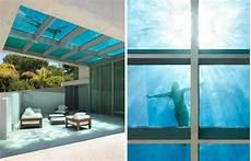 innovative acrylics installs glass bottom pool in