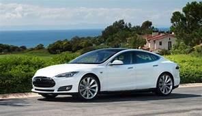 Tesla Unveils Technology To Swap EV Batteries In 90