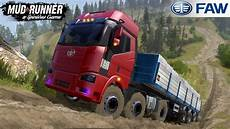 spintires mudrunner faw truck drives uphill with a