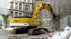 bagger new kobelco e385 rei 223 t eine betonwand um