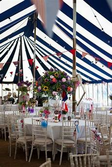 striped wedding theme in a traditional striped marque to create a very british summer theme