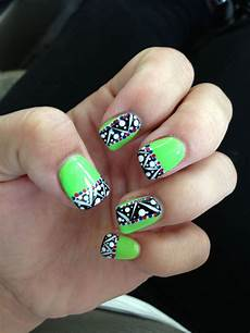 lime green nails with tribal pattern done at envy nail