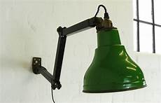 vintage industrial black wall mounted light with green enamel shade