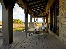 rustic covered deck with stone walls hgtv