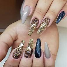 50 beautiful black and gold nail designs that will make