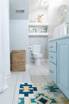 kids bathroom remodel with pops of light turquoise yellow and green