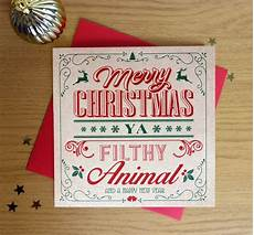 merry christmas ya filthy animal christmas card by paperjoystudios