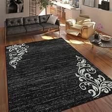 tapis salon moderne poils ras multicolore motif floral