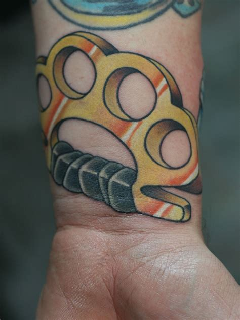 Brass Knuckles Tattoo Meaning