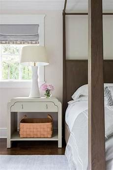 interesting light wood accents and furnishings add sophistication and a light gray nightstand brings a clean sophisticated