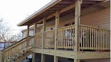 kansas city deck build deck over hang with shingle roof pics ad construction services