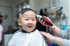 chinese children get haircuts on traditional head shaving