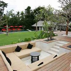 Sunken Cabana With Throw Cushions At End Of Garden