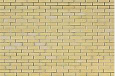 wall of small light yellow bricks the texture of the