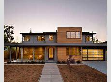 Wood and stucco ranch exterior. cedar boards. Front door