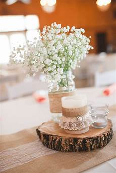 wooden slab centerpiece with burlap and lace striking