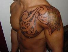 amazing tribal on chest and left shoulder