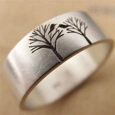 wedding band or engagement ring with bird in a tree by