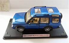 how can i learn about cars 2004 land rover discovery head up display motor max 2004 land rover discovery diecast suv 1 18 scale blue 73100pf mmx2002 cars and