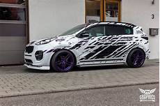 tuned kia sportage rides low has skirts and spoilers