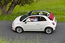 2012 white fiat 500c driving side view eurocar news