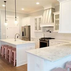 white kitchen cabinets painted sherwin williams quot extra white quot wall paint color sherwin williams