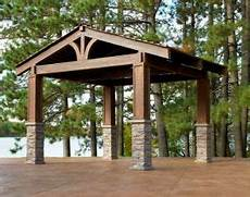 rustic pergola with metal roof or cedar shakes stone the house project rustic pergola