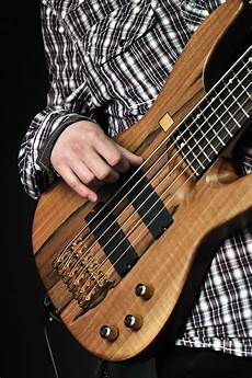 how to play a bass guitar bass guitar chords for beginners melodyful