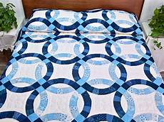 navy blue and cream double wedding ring quilt