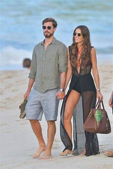 izabel goulart and kevin trapp walk the in st barth