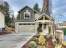house plans for narrow lots with front garage narrow lot craftsman in two versions architectural