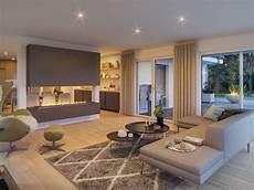 wohnung modern einrichten wohnzimmer mit kamin als raumteiler bungalow haus innen