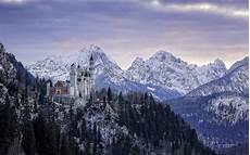 winter germany iphone wallpaper winter landscape background alps and neuschwanstein castle