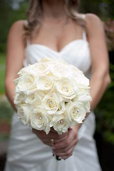 white rose bouquet with bling flowers wedding bouquets