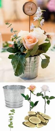 recreate this adorable tin bucket centerpiece with