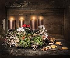 rustic advent wreath with four burning candles and
