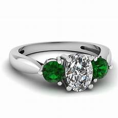 3 stone tapered engagement ring with emerald in 950 platinum fascinating diamonds