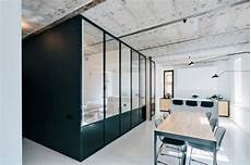 contrasting minimalist apartment with a black steel window