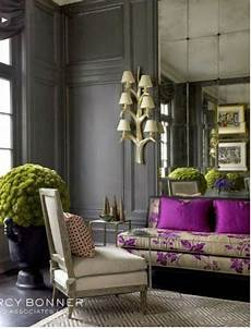 purple and gray living room decor wood paneled living room purple pillows traditional home
