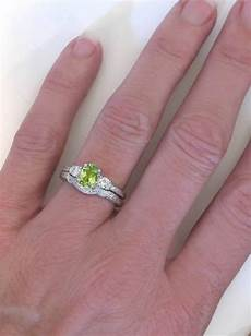 peridot diamond engagement ring in vintage three stone design with engraving and a matching