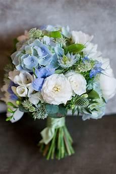 fresh fun relaxed blue green wedding bouquets