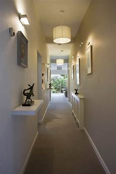 hallway illuminated with drum shade pendants and wall sconces hallway lighting fixtures that