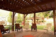 backyard deck pergola lattice fullwrap cantilever roof western timber frame
