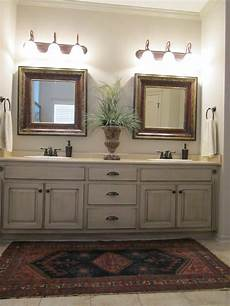 love these painted bathroom cabinets and the lights what i would like to paint all the cabinets