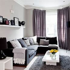 purple and gray living room decor grey traditional living room with purple soft furnishings